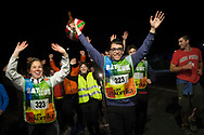 """People wave the arms as they  run on the 20th Korrika. Castejon. (Basque Country). March 31, 2017. The """"Korrika"""" is a relay course, with a wooden baton that passes from hand to hand without interruption, organised every two years in a bid to promote the basque language. The Korrika runs over 11 days and 10 nights, crossing many Basque villages and cities. This year was the 20th edition and run more than 2500 Kilometres. Some people consider it an honour to carry the baton with the symbol of the Basques, """"buying"""" kilometres to support Basque language teaching. (Gari Garaialde / Bostok Photo)"""