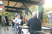 SHOT 9/23/16 5:27:22 PM - Guests enjoy happy hour at the Ale House at Amato's upstairs patio in Denver, Co. The Ale House at Amato's  is a bar and grill offering 40-plus tap beers and a rooftop patio with sweeping views of the downtown Denver skyline. (Photo by Marc Piscotty / © 2016)