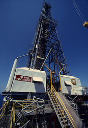 Stock photo of an offshore jack-up drilling rig derrick with pipe racked