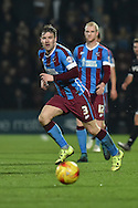Scott Laird of Scunthorpe United kicks forward  during the Sky Bet League 1 match between Scunthorpe United and Wigan Athletic at Glanford Park, Scunthorpe, England on 2 January 2016. Photo by Ian Lyall.