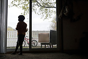 HOPKINS, MN - APRIL, 27: Abdullahi, 5, stands by the sliding glass door in his family's apartment in Hopkins, Minn., Thursday April 27, 2017. Though two of his siblings contracted the measles during the current outbreak in Minneapolis and are now recovering at home, he received one dose of the vaccine in January and did not get sick.