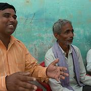 CAPTION: Rammurat Yadav (left), Pradhan (leader) of Baharayen, meets with residents of the village who'd like to set up micro enterprises drawing on electricity generated under the SPEED initiative. LOCATION: Baharayen, Faizabad District, Uttar Pradesh, India. INDIVIDUAL(S) PHOTOGRAPHED: From left to right - Rammurat Yadav, Ram Khilavan and Vikas Dubey.