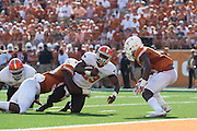 AUSTIN, TX - SEPTEMBER 26:  Rennie Childs #23 of the Oklahoma State Cowboys is wrapped up by the Texas Longhorns during the 3rd quarter on September 26, 2015 at Darrell K Royal-Texas Memorial Stadium in Austin, Texas.  (Photo by Cooper Neill/Getty Images) *** Local Caption *** Rennie Childs