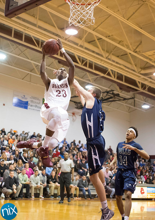 Jay M Robinson's Lavar Batts, Jr. (23) goes up for two points against Hickory Ridge during a 3A west state basketball playoff game Thursday, February 25, 2016 at Jay M Robinson High School in Concord, NC. Photo by JASON E. MICZEK - www.miczekphoto.com