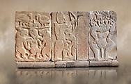 Pictures & images of the North Gate Hittite sculpture stele depicting Hittite Gods. 8th century BC. Karatepe Aslantas Open-Air Museum (Karatepe-Aslantaş Açık Hava Müzesi), Osmaniye Province, Turkey. Against art background