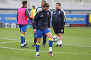 AFC Wimbledon defender Callum Kennedy (23) warming up during the The FA Cup match between AFC Wimbledon and Lincoln City at the Cherry Red Records Stadium, Kingston, England on 4 November 2017. Photo by Matthew Redman.