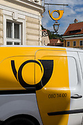 A van and logo from the Slovenian postal service Posta Slovenije outside the post office in rural Slovenia, on 26th June 2018, in Kamnik, Slovenia.