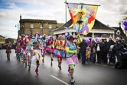 January 14, 2017 - Whittlesey, Cambridgshire, UK - Whittlesey UK. Picture shows the Gog Magog Molly dancers at the 38th Whittlesey Straw Bear Festival this weekend. In times past when starvation bit deep the ploughmen of the area where drawn to towns like Whittlesey, They knocked on doors begging for food & disguised their shame by blackening their faces with soot. In Whittlesey it was the custom on the Tuesday following Plough Monday to dress one of the confraternity of the plough in straw and call him a Straw Bear. The bear was then taken around town to entertain the folk who on the previous day had subscribed to the rustics, a spread of beer, tobacco & beef. The bear was made to dance in front of houses & gifts of money, beer & food was expected. (Credit Image: © Andrew Mccaren/London News Pictures via ZUMA Wire)