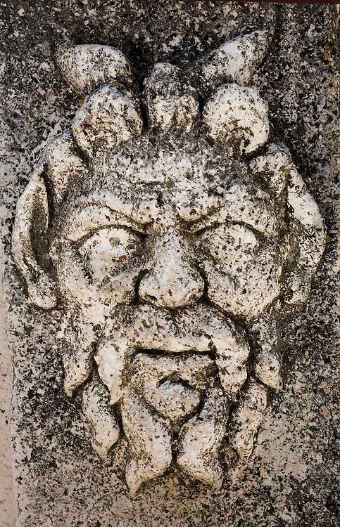 Relief head of a bearded and horned (?) man's head, on a pillar in the Roman forum, Zadar, Croatia