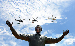 Military helicopters fly past the new statue of former President Nelson Mandela at the Union Buildings in Pretoria. 161213.<br />Picture: Chris Collingridge/African News Agency(ANA)