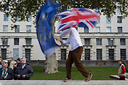 On the day that Members of Parliament sat on a Saturday (the first time in 37 years and dubbed 'Super Saturday') in order to vote for Prime Minister Boris Johnson's Brexit deal with the EU in Brussels, a young man waves an EU and Union Jack flags alongside a million Remainers (according to organisers) who marched through the capital to voice their opposition to a Brexit and calling for a peoples' Vote, on 19th October 2019, in London, England.