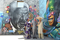 The Prince of Wales and Duchess of Cornwall stand with the Second Lady of the Republic of Ghana Samira Bawumia (left) in front of a mural of Kofi Annan, during a visit to the Jamestown Cafe in Accra, Ghana, on day four of their trip to west Africa.