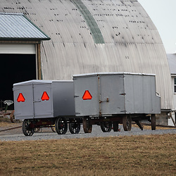 Specially built wagons used by Amish to transport benches for worship services from one farm to another.