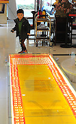 TAIYUAN, CHINA - NOVEMBER 19: (CHINA OUT) <br /> <br /> Twelve-meter-long Golden Road <br /> <br /> People walk on twelve-meter-long golden road on November 19, 2014 in Taiyuan, Shanxi province of China. A jewelry shop paved a twelve-meter-long road with gold coins during its upcoming shop celebration at the shopping mall to attract consumers.<br /> ©Exclusivepix