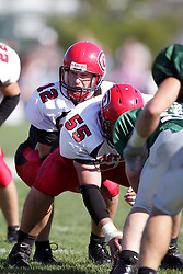 04 October 2008: Evan Jones barks a play while under center Matt Favero in a battle between the Carthage Red Men and the Illinois Wesleyan University Titans, Game action was at Wilder Field on the campus of Illinois Wesleyan University in Bloomington Illinois.