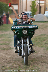 Jacq Brandt rides in Timmy Marr's chopper-bagger the tour-pack during the Run to Raton. Raton, NM. USA. Saturday July 21, 2018. Photography ©2018 Michael Lichter.