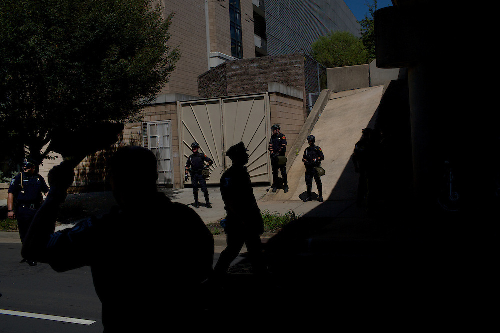Police officers line the streets as protesters participate in a march during 2012 Democratic National Convention on Sunday, September 2, 2012 in Charlotte, NC.