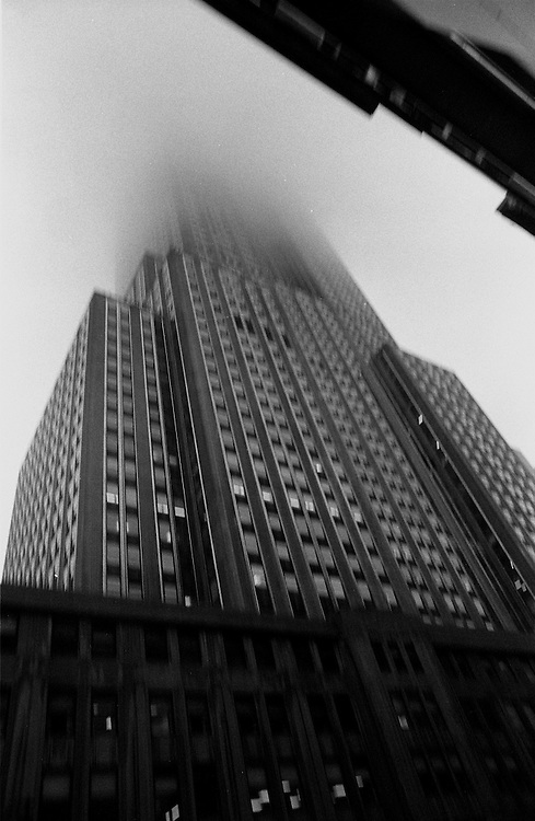 """Empire State Building during rainstorm and fog...Part of long-term (2005-2008) story """"I See A Darkness"""". New York, NY."""