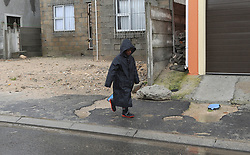 """South Africa - Cape Town - 10 June 2020 - Boy walkling home in the rain as a intense cold front hits Cape Town causing extremely cold temperatures, strong winds and rain. Picture"""" Brendan Magaar/African News Agency(ANA)"""