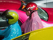 "16 SEPTEMBER 2015 - BANGKOK, THAILAND: Men with ponchos on a motorcycle during a rainstorm in Bangkok. The remnants of tropical storm ""Vamco"" hit Bangkok Wednesday. The storm, downgraded to a tropical depression, brought bands of rain to central Thailand, including Bangkok. The Thai Meteorological Department said the storm would help alleviate the drought that has gripped Thailand since late last year.     PHOTO BY JACK KURTZ"
