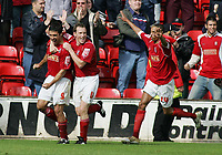 Photo: Paul Thomas.<br /> Walsall v Southend. Coca Cola League 1.<br /> 13/08/2005.<br /> <br /> Darren Wrack and Mark Wright celebrate with goal scorer Jorge Leitao.