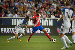 """September 1, 2017 - Harrison, New Jersey, U.S - USMNT defender JORGE VILLAFA""""A (2). Fights for the ball against Costa Rica forward BRYAN RUIZ (10) while USMNT defender TIM REAM (14) looks on during a World Cup qualifier match at Red Bull arena in Harrison, NJ.  Costa Rica defeats USA 2 to 0. (Credit Image: © Mark Smith via ZUMA Wire)"""