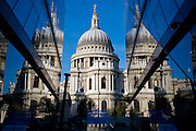 The dome of St Paul's Cathedral reflected in the windows of the One New Change shopping centre.  The City of London.