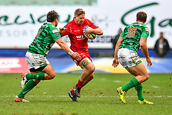 Scarlets' James Davies is tackled by Benetton Treviso's Tizano Pasquali<br /> <br /> Photographer Simon King/Replay Images<br /> <br /> EPCR Champions Cup Round 3 - Scarlets v Benetton Rugby - Saturday 9th December 2017 - Parc y Scarlets - Llanelli<br /> <br /> World Copyright © 2017 Replay Images. All rights reserved. info@replayimages.co.uk - www.replayimages.co.uk