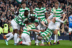 Celtic's Scott Brown (bottom right) takes a tumble as they celebrate after Tomas Rogic (obscured) scores his side's first goal of the game during the William Hill Scottish Cup semi final match at Hampden Park, Glasgow.