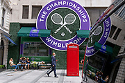 The logo for the Lawn Tennis Association's (LTA) Wimbledon tennis championship is reflected in the polished bodywork of a limousine, outside style retailer, Ralph Lauren in Bond Street, on 8th July 2021, in London, England.