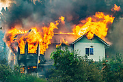 A burning home near N. Slope Drive off of Highway 299 in Redding during the Carr Fire on Friday, July 27, 2018, in Shasta County, Calif.