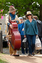 © Licensed to London News Pictures. 30/05/2016. Hay-on-Wye, Powys, Wales, UK. Musicians arrive at the Globe festival site on the fifth day of 'HowTheLightGetsIn' Festival of Ideas - The philosophy and music festival at Hay-on-Wye, Wales, UK. HowTheLightGetsIn festival was founded by post-realist philosopher and director of the Institute of Art and Ideas, Hilary Lawson. Photo credit: Graham M. Lawrence/LNP