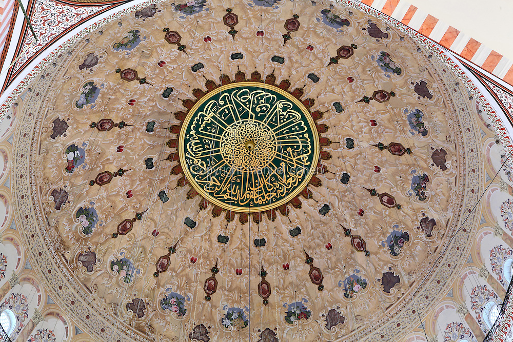 Central dome of the Suleymaniye Mosque or Mosque of Sultan Suleyman the Magnificent (Suleymaniye Camii), 1550-57, by Mimar Sinan, Istanbul, Marmara, Turkey. This Ottoman Imperial mosque, commissioned by Suleyman the Magnificent, and located on Istanbul's Third Hill, was restored in 1665 after a fire, in 1766 due to an earthquake and in 1956 after damage in World War I. It is the largest mosque in Istanbul. The historical areas of the city were declared a UNESCO World Heritage Site in 1985. Picture by Manuel Cohen.