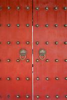 red doors detail of Wen Miao confucian confucius temple in Shanghai China popular republic