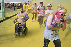 © Licensed to London News Pictures. 20/09/2014. Brighton, UK. The Brighton Dulux Color Run, Also known as the happiest 5K on the planet took place on Brighton Seafront. Thousands of runners raising money for charity by completing the 5 kilometre course where at each km they are covered in a different colour by the organisers. At the end of the course the runners arrive at the Color festival with music and major powder burst creating a fantastic atmosphere. Photo credit : Hugo Michiels/LNP