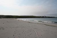 Sandy blue flag beach on the Aran Islands County Galway Ireland