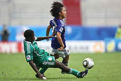 17.07.2010,  Augsburg, GER, FIFA U20 Womens Worldcup, Nigeria vs Japan,  im Bild Martina OHADUGHA (Nigeria Nr.4) im Kampf mit Mana IWABUCHI  (Japan Nr.10) , EXPA Pictures © 2010, PhotoCredit: EXPA/ nph/ . Straubmeier+++++ ATTENTION - OUT OF GER +++++ / SPORTIDA PHOTO AGENCY