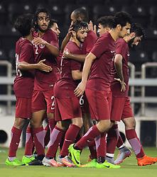 Meshaal Al Shamari (C)of Qatar celebrates with his team mates after scoring third goal against Singapore during a U22 International  friendly soccer match at the Jassim Bin Hamad Stadium in Doha, capital of Qatar ,June 15,2017.Qatar won 3-0  (Credit Image: © Nikku/Xinhua via ZUMA Wire)