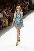 Mini skirt in fringe, print top and matching jacket. By Custo Barcelona at the Spring 2013 Fashion Week show in New York.