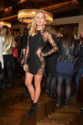 KIMBERLEY GARNER at a party to celebrate the 15th anniversary of Myla held at the House of Myla, 8-9 Stratton Street, London on 21st October 2014.