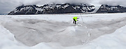 U. S. Geological Survey glaciologist Shad O'Neel measures the length of an exposed mass balance stake at Columbia Glacier, Alaska.