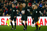 Assistant referee Lee Betts, Referee Martin Atkinson, Assistant Referee Harry Lennard, during The FA Cup 3rd round match between Crystal Palace and Grimsby Town FC at Selhurst Park, London, England on 5 January 2019.