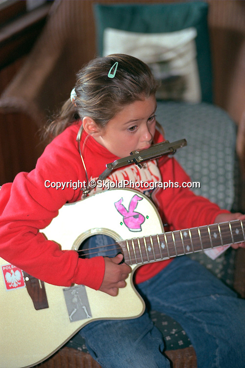 Talented girl age 6 performing one man band show.  Cedarville  Michigan USA
