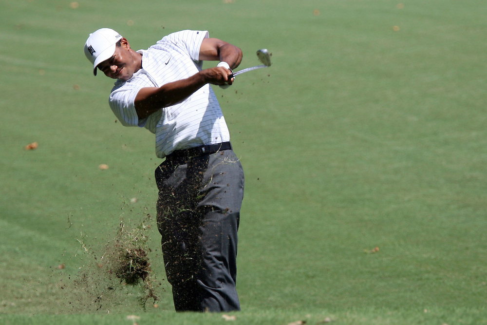 09 August 2007: Tiger Woods hits out of the rough on the 4th hole during the first round of the 89th PGA Championship at Southern Hills Country Club in Tulsa, OK.