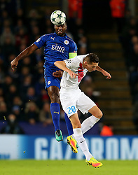 Wes Morgan of Leicester City wins a header above Hans Vanaken of Club Brugge - Mandatory by-line: Matt McNulty/JMP - 22/11/2016 - FOOTBALL - King Power Stadium - Leicester, England - Leicester City v Club Brugge - UEFA Champions League