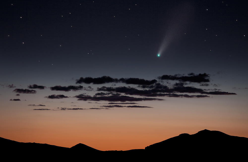Comet NEOWISE slices through the night sky like a ghostly knife over the Never Summer Mountains. The coma glows a brilliant emerald green from diatomic carbon molecules venting out from the comet's surface. What a privilege to witness this ephemeral spectacle in my lifetime!!!