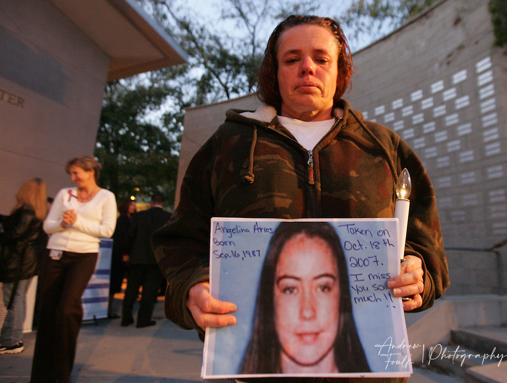 /Andrew Foulk/ For the Californian/.Julie Aries, holds onto a picture of Angelina Aries, who was killed at the age of twenty, during a carjacking. Julie came out to the Community Rec Center in Temecula, to participates in a candlelight vigil as part of National crime victim's rights week.