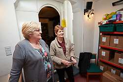 "© Licensed to London News Pictures.  30/05/2013. LITTLE CHALFONT, UK. Volunteers Clare Callaghan (R) and Gill Seymour (L) staff a food bank in St George's Church in Little Chalfont. Despite being one of the picturesque villages collectively known as the Chalfonts with multi-million pound houses and cottages, a significant percentage of the population is considered ""hard pressed"" by the local council. According to the Trussell Trust, the largest charity providing emergency food relief, use of their 325 food banks has tripled over the last year to 350,000. Photo credit: Cliff Hide/LNP"