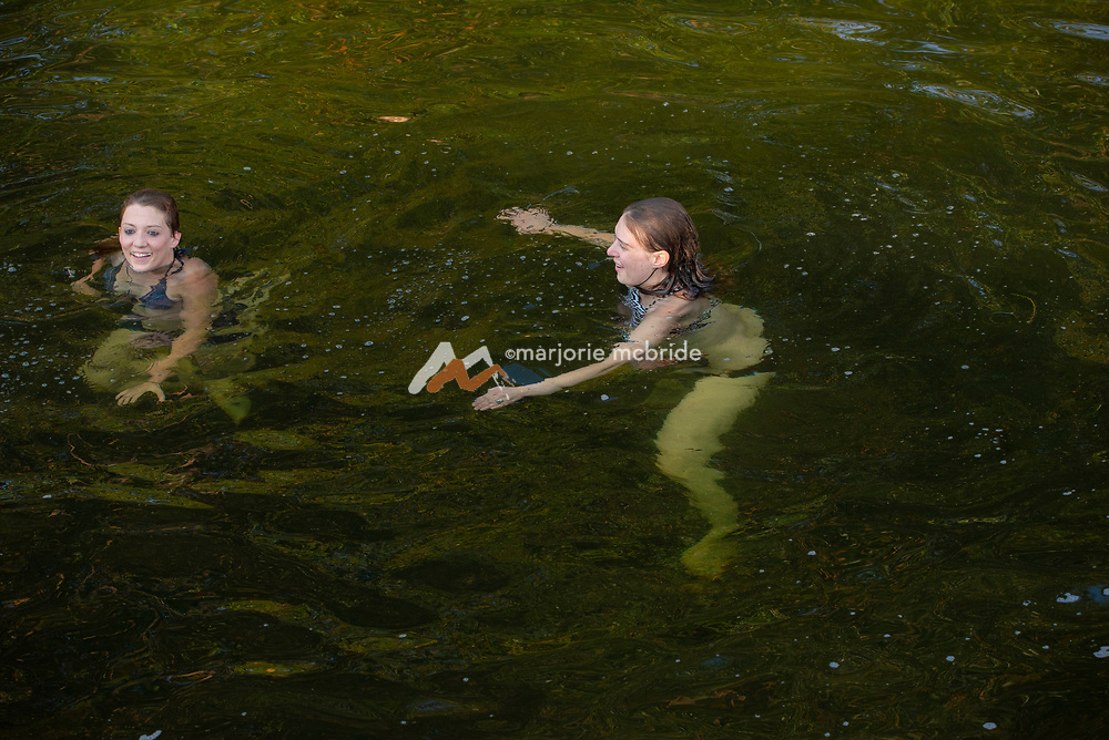 Girls swimming at the Ledges swimming hole in Richfield, Idaho.