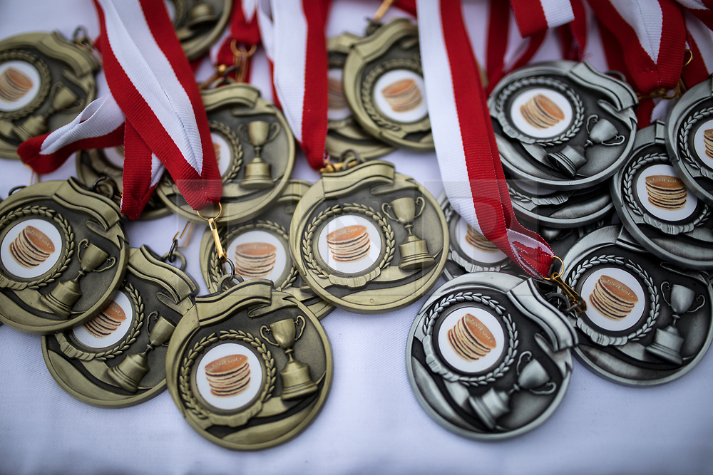 © Licensed to London News Pictures. 13/02/2018. London, UK. Medals at the Rehab Parliamentary Pancake Race 2018 in Victoria Tower Gardens. The Parliament Team - made up of MPs, Lords and Ladies - race in a relay against the Media Team - made up of reporters and presenters - whilst continuously flipping pancakes to celebrate Shrove Tuesday, also known as Pancake Day. Photo credit : Tom Nicholson/LNP